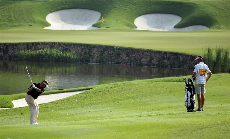 KUALA LUMPUR, MALAYSIA - MARCH 05:  Darren Clarke of Northern Ireland plays his second shot on the 14th hole during the the second round of the Maybank Malaysian Open at the Kuala Lumpur Golf and Country Club on March 5, 2010 in Kuala Lumpur, Malaysia.  (Photo by Andrew Redington/Getty Images)