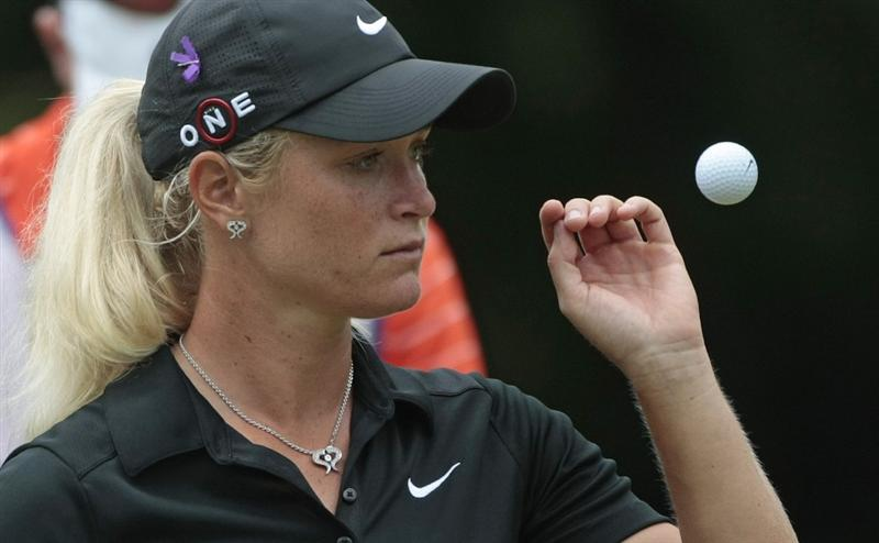MOBILE, AL - MAY 16:  Suzann Pettersen of Norway tosses her ball on the second hole during final round play in the Bell Micro LPGA Classic at the Magnolia Grove Golf Course on May 16, 2010 in Mobile, Alabama.  (Photo by Dave Martin/Getty Images)