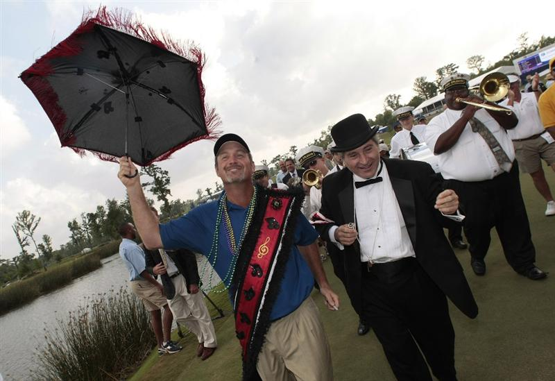 AVONDALE, LA - APRIL 26: Zurich Classic winner Jerry Kelly leads a New Orleans jazz band second-line parade off the 18th green after his win during the final round of the Zurich Classic at TPC Louisiana on April 26, 2009  in Avondale, Louisiana. (Photo by Dave Martin/Getty Images)