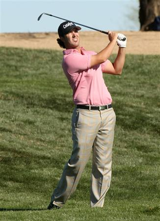 SCOTTSDALE, AZ - JANUARY 31: Scott Piercy hits his second shot on the second hole during the third round of the FBR Open on January 31, 2009 at TPC Scottsdale in Scottsdale, Arizona.  (Photo by Stephen Dunn/Getty Images)