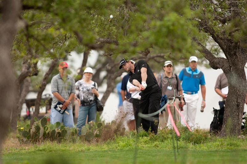 SAN ANTONIO, TX - APRIL 14: James Driscoll plays a shot from the rough during the first round of the Valero Texas Open at the AT&T Oaks Course at TPC San Antonio on April 14, 2011 in San Antonio, Texas. (Photo by Darren Carroll/Getty Images)