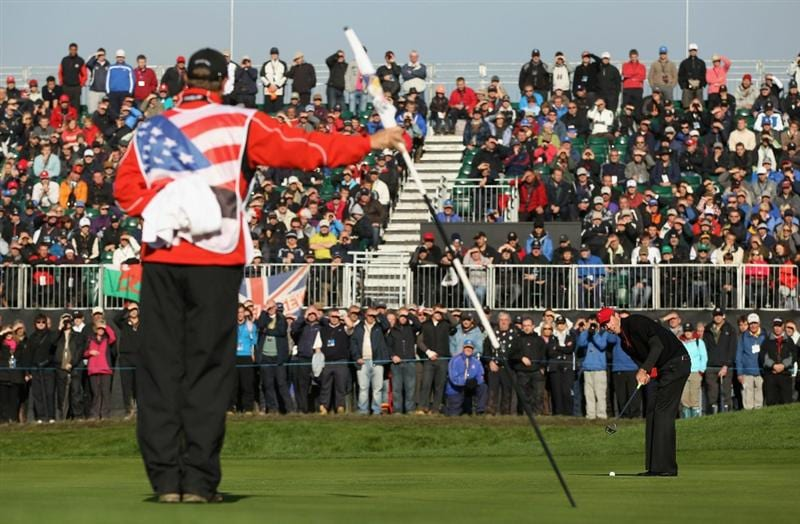 NEWPORT, WALES - OCTOBER 04:  Matt Kuchar of the USA hits a putt on the first green as his caddie Lance Bennett looks on in the singles matches during the 2010 Ryder Cup at the Celtic Manor Resort on October 4, 2010 in Newport, Wales.  (Photo by Ross Kinnaird/Getty Images)