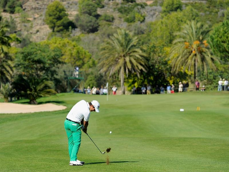 CASTELLON DE LA PLANA, SPAIN - OCTOBER 24:  Matteo Manassero of Italy plays his approach shot on the third hole during the final round of the Castello Masters Costa Azahar at the Club de Campo del Mediterraneo on October 24, 2010 in Castellon de la Plana, Spain.  (Photo by Stuart Franklin/Getty Images)
