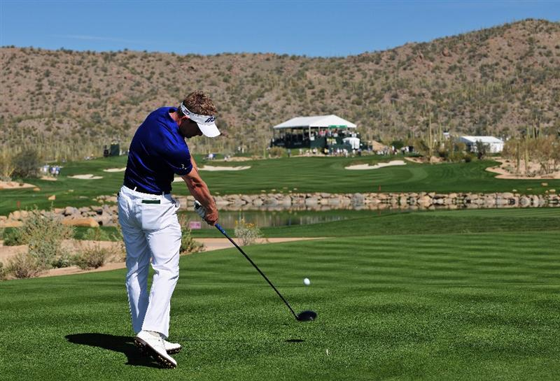 MARANA, AZ - FEBRUARY 27:  Luke Donald of England plays his tee shot on the fourth hole during the third round of Accenture Match Play Championships at Ritz - Carlton Golf Club at Dove Mountain on February 27, 2009 in Marana, Arizona.  (Photo by Stuart Franklin/Getty Images)