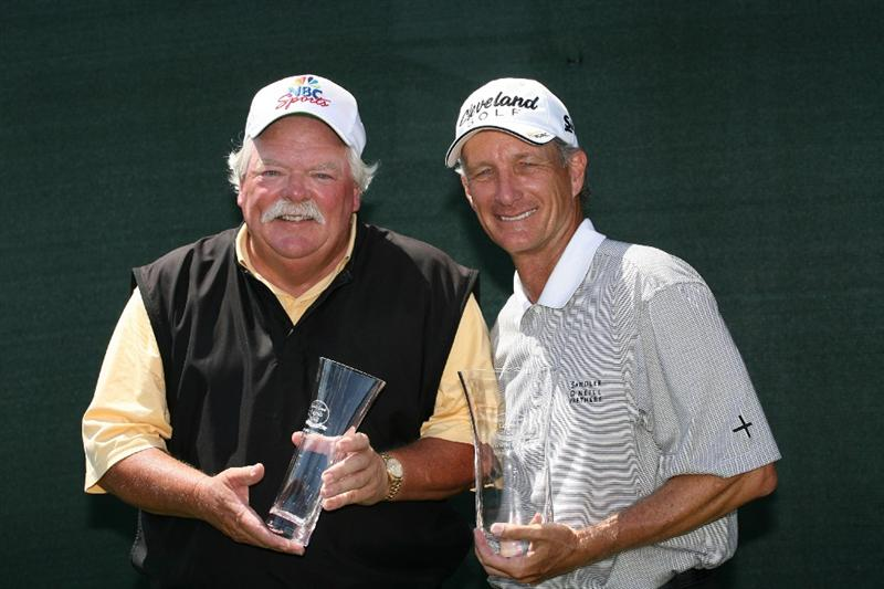 SAVANNAH, GA - APRIL 25:  Roger Maltbie (L) and Gary Koch (R) hold their championship trophies after winning the Raphael Division of the Liberty Mutual Legends of Golf at the Westin Savannah Harbor Golf Resort and Spa on April 25, 2009 in Savannah, Georgia. (Photo by Hunter Martin/Getty Images)