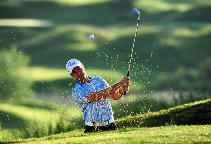 MADRID, SPAIN - MAY 27:  Steve Webster of England plays his bunker shot during the first round of the Madrid Masters at Real Sociedad Hipica Espanola Club De Campo on May 27, 2010 in Madrid, Spain.  (Photo by Stuart Franklin/Getty Images)