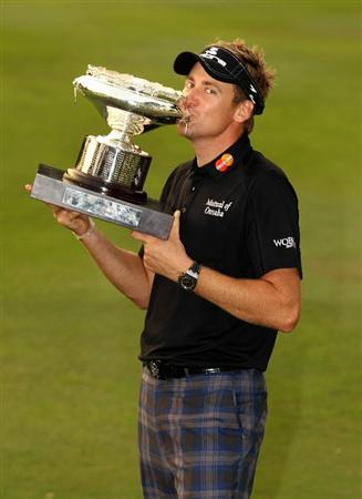 HONG KONG - NOVEMBER 21:  Ian Poulter of England celebrates with the trophy after winning the UBS Hong Kong Open at The Hong Kong Golf Club on November 21, 2010 in Hong Kong, Hong Kong.  (Photo by Ian Walton/Getty Images)