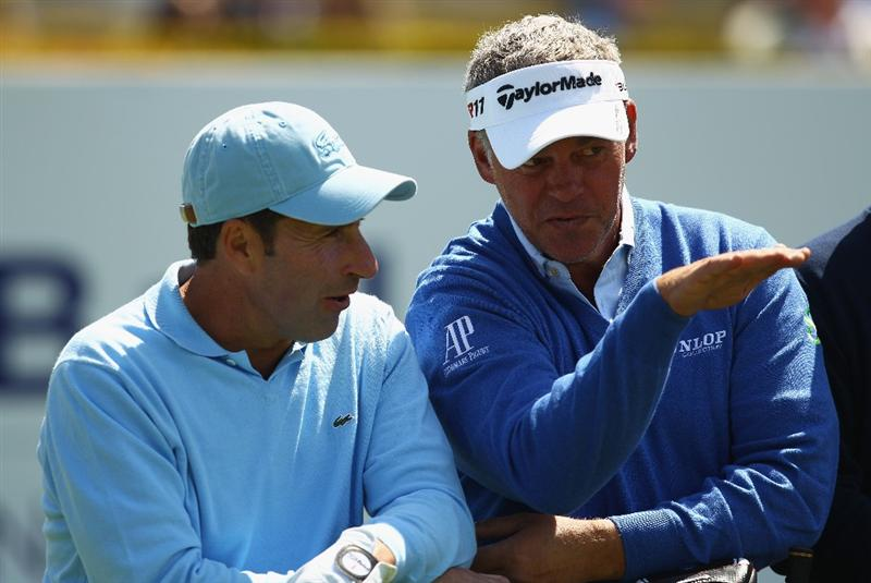 VIRGINIA WATER, ENGLAND - MAY 23:  Jose Maria Olazabal of Spain and Darren Clarke of Northern Ireland share a joke before the 'Ole Seve' Pro-Am in aid of the Seve Ballesteros Foundation at Wentworth Club on May 23, 2011 in Virginia Water, England.  (Photo by Richard Heathcote/Getty Images)