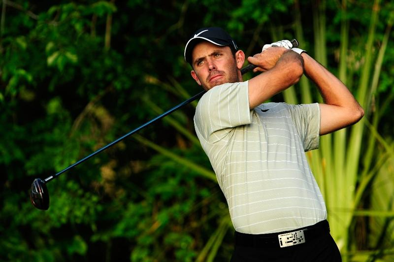PONTE VEDRA BEACH, FL - MAY 05:  Charl Schwartzel of South Africa hits a shot during a practice round prior to the start of THE PLAYERS Championship held at THE PLAYERS Stadium course at TPC Sawgrass on May 5, 2010 in Ponte Vedra Beach, Florida.  (Photo by Sam Greenwood/Getty Images)