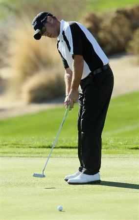 LA QUINTA, CA - JANUARY 21:  Brian Davis of England hits a putt on the first green during the third round of the Bob Hope Classic at the Silver Rock Resort on January 21, 2011 in La Quinta, California.  (Photo by Jeff Gross/Getty Images)