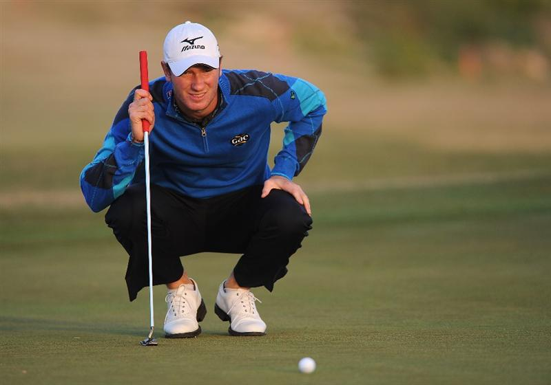 RAGUSA, ITALY - MARCH 18:  Chris Wood of England lines up his putt on the 18th hole during the second round of the Sicilian Open at the Donnafugata golf resort and spa on March 18, 2011 in Ragusa, Italy.  (Photo by Stuart Franklin/Getty Images)