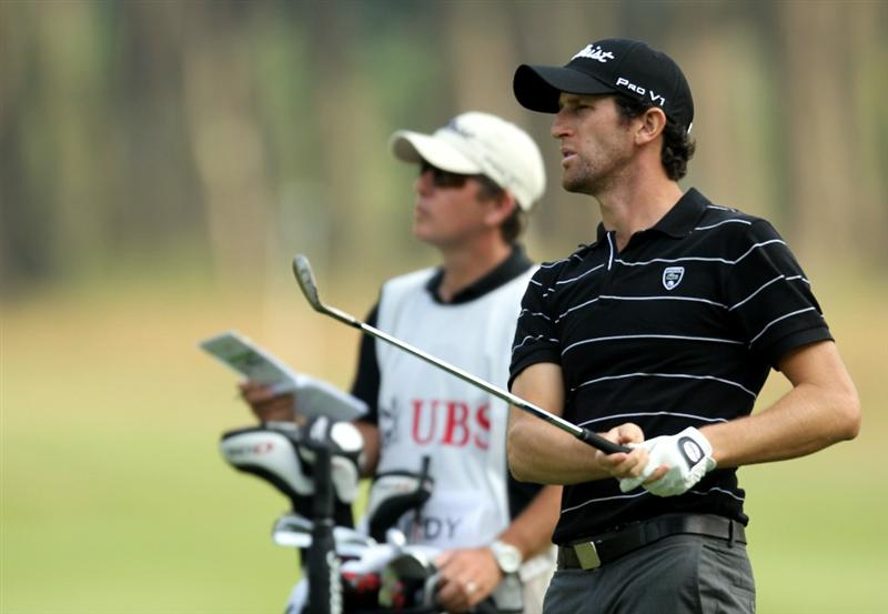HONG KONG - NOVEMBER 19: Gregory Bourdy of France watches his shot on the 7th hole during day two of the UBS Hong Kong Open at The Hong Kong Golf Club on November 19, 2010 in Hong Kong, Hong Kong. ( Photo By : Stanley Chou/Getty Images )