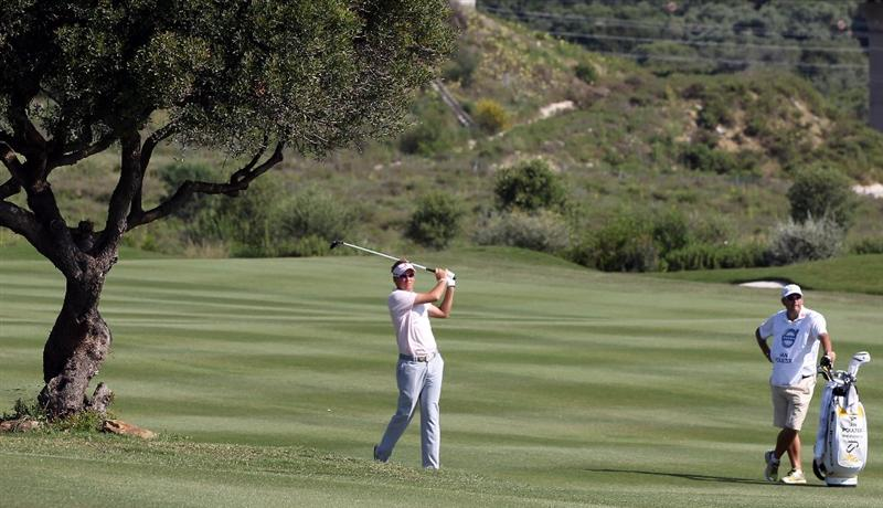 CASARES, SPAIN - MAY 22:  Ian Poulter of England during the semi-final of the Volvo World Match Play Championship at Finca Cortesin on May 22, 2011 in Casares, Spain.  (Photo by Ross Kinnaird/Getty Images)