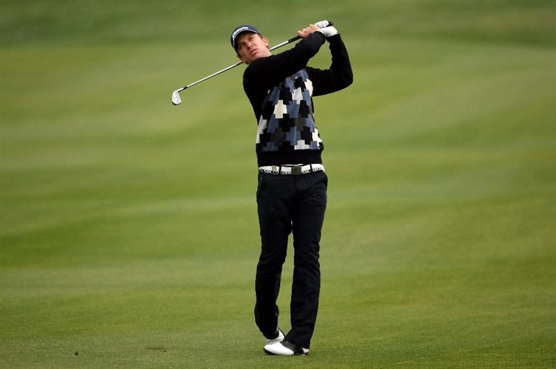 DOHA, QATAR - JANUARY 23:  Magnus A Carlsson of Sweden hits his second shot on the sixth hole during the second round of  the Commercialbank Qatar Masters at Doha Golf Club on January 23, 2009 in Doha, Qatar.  (Photo by Andrew Redington/Getty Images)