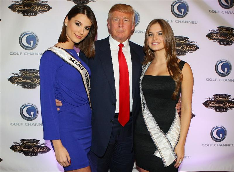 NEW YORK - MARCH 31:  Miss Universe Stefania Fernandez, Donald Trump and Miss Teen USA Stormi Bree Henley pose for a photo prior to a special screening of Golf Channel's new celebrity reality series, Donald J Trump's Fabulous World of Golf on March 31, 2010 at Trump Towers in New York, New York.  (Photo by Mike Stobe/Getty Images for Golf Channel)