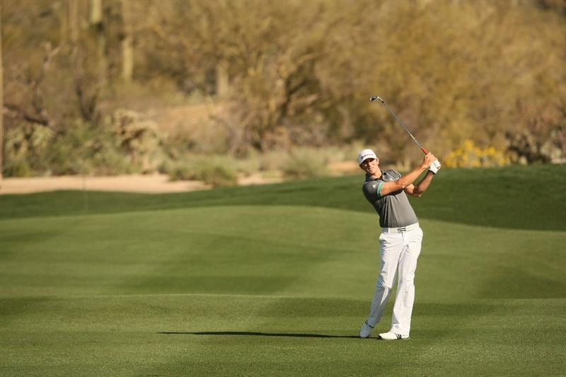 MARANA, AZ - FEBRUARY 17:  Dustin Johnson plays a shot on the sixth hole during round one of the Accenture Match Play Championship at the Ritz-Carlton Golf Club on February 17, 2010 in Marana, Arizona.  (Photo by Darren Carroll/Getty Images)