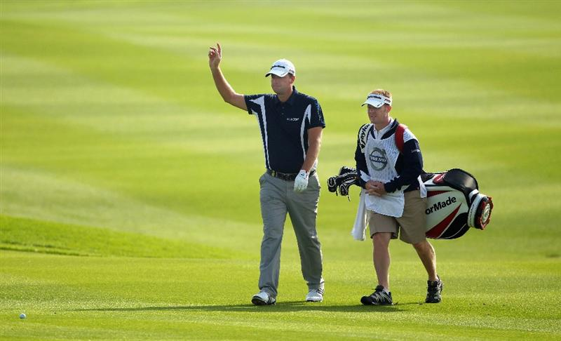 BAHRAIN, BAHRAIN - JANUARY 27:  Peter Hanson of Sweden walks with his caddie on the 13th hole during the first round of the Volvo Golf Champions at The Royal Golf Club on January 27, 2011 in Bahrain, Bahrain.  (Photo by Andrew Redington/Getty Images)