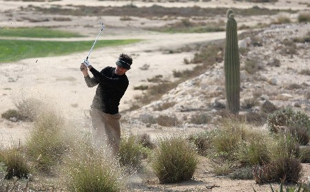 DOHA, QATAR - JANUARY 24:  Jean Van de Velde of France plays left handed from the scrub on the 14th  hole during the first round of the Commercial Bank Qatar Masters held at the Doha Golf Club on January 24, 2008 in Doha,Qatar.  (Photo by Ross Kinnaird/Getty Images)