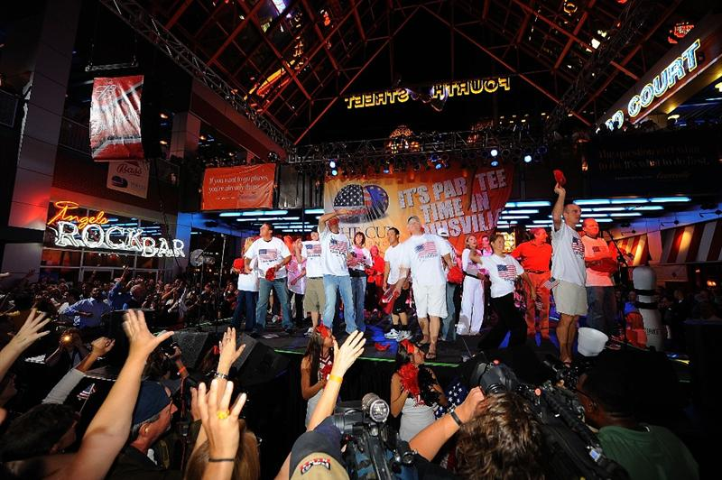 LOUISVILLE, KY - SEPTEMBER 18: Members of the USA team toss caps to the crowd at the downtown Ryder Cup pep rally prior to the start of the 2008 Ryder Cup on September 18, 2008 in Louisville, Kentucky. (Photo by Sam Greenwood/Getty Images)