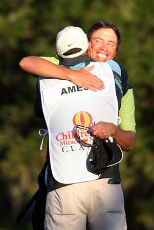 LAKE BUENA VISTA, FL - NOVEMBER 15:  Stephen Ames from Canada hugs his caddie after winning a playoff in the final round at the Children's Miracle Network Classic at Disney's Magnolia & Disney's Palm Course on November 15, 2009 in Lake Buena Vista, Florida.  (Photo by Marc Serota/Getty Images)