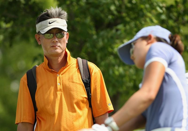 SPRINGFIELD, IL - JUNE 05:  B.J. Wie watches his daughter Michelle Wie practice chipping after the second round of the LPGA State Farm Classic golf tournament at Panther Creek Country Club on June 5, 2009 in Springfield, Illinois.  (Photo by Christian Petersen/Getty Images)