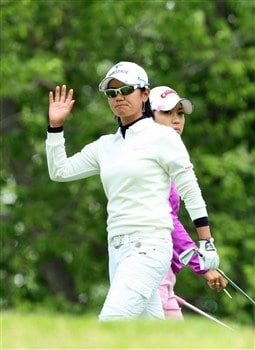 EDINA, MN - JUNE 28:  Ai Miyazato of Japan at the 4th hole is shadowed by her playing partner Momoko Ueda of Japan during the third round of the 2008 U.S. Women's Open Championship held at Interlachen Country Club on June 28, 2008 in Edina, Minnesota.  (Photo by David Cannon/Getty Images)