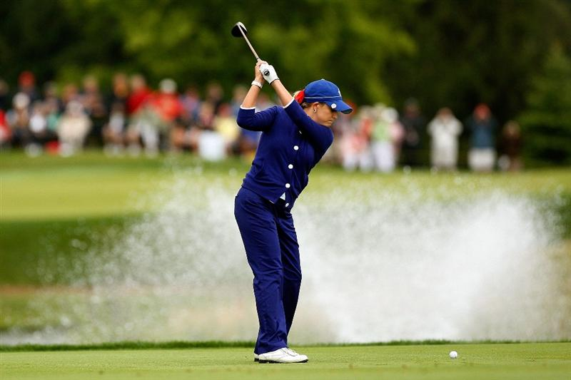 SUGAR GROVE, IL - AUGUST 21:  Cristie Kerr of the U.S. Team hits her second shot on the second hole during the Friday morning Fourball matches at the 2009 Solheim Cup at Rich Harvest Farms on August 21, 2009 in Sugar Grove, Illinois.  (Photo by Chris Graythen/Getty Images)