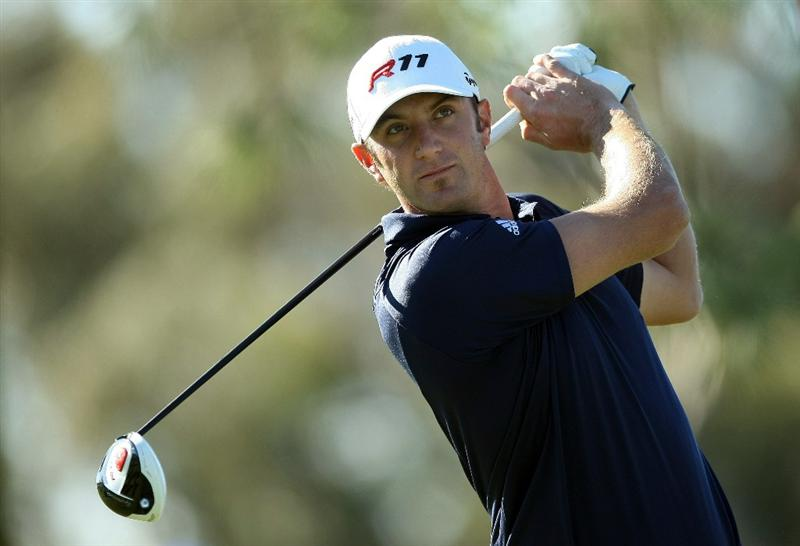LA JOLLA, CA - JANUARY 28:  Dustin Johnson tees off the 11th hole during the second round of the Farmers Insurance Open at Torrey Pines on January 28, 2011 in La Jolla, California. (Photo by Donald Miralle/Getty Images)