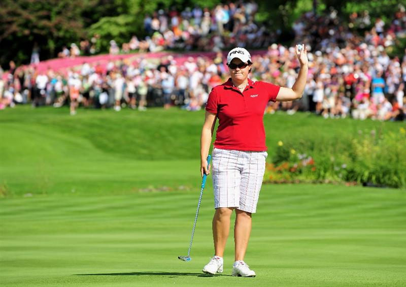 EVIAN-LES-BAINS, FRANCE - JULY 25:  Becky Brewerton of Wales celebrates on the 18th hole during the third round of the Evian Masters at the Evian Masters Golf Club on July 25, 2009 in Evian-les-Bains, France.  (Photo by Stuart Franklin/Getty Images)