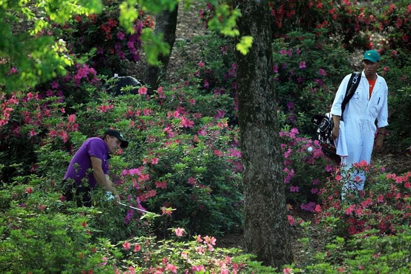 AUGUSTA, GA - APRIL 07:  Phil Mickelson plays his second shot from the flowers on the 13th hole during the first round of the 2011 Masters Tournament at Augusta National Golf Club on April 7, 2011 in Augusta, Georgia.  (Photo by David Cannon/Getty Images)