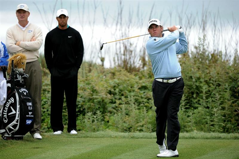 PEBBLE BEACH, CA - JUNE 18:  Lee Westwood of England hits his tee shot on the 11th hole as Ernie Els and Tiger Woods look on during the second round of the 110th U.S. Open at Pebble Beach Golf Links on June 18, 2010 in Pebble Beach, California.  (Photo by Harry How/Getty Images)