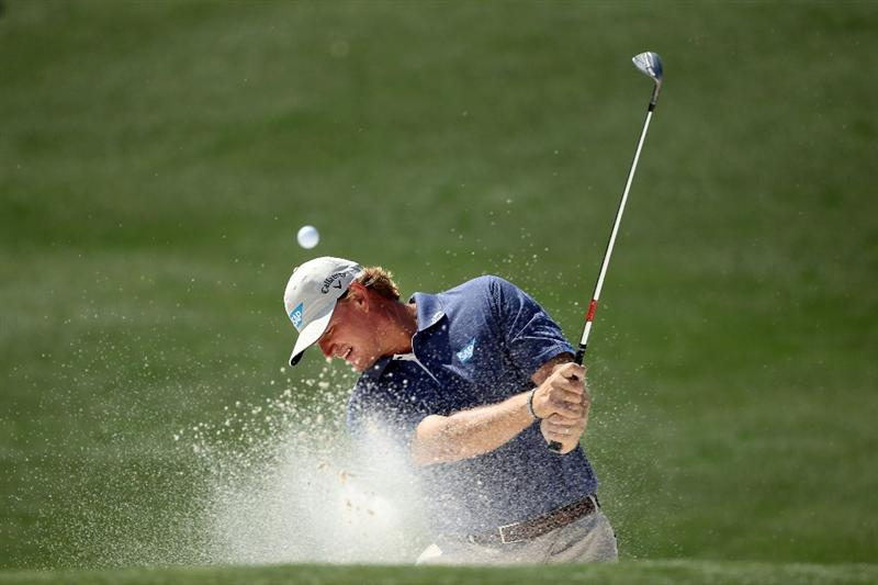 AUGUSTA, GA - APRIL 04:  Ernie Els of South Africa plays a bunker shot during a practice round prior to the 2011 Masters Tournament at Augusta National Golf Club on April 4, 2011 in Augusta, Georgia.  (Photo by Andrew Redington/Getty Images) *** BESTPIX ***