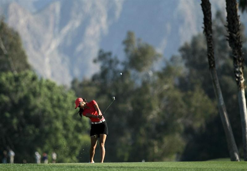RANCHO MIRAGE,CA - APRIL 3:  Michelle Wie hits her approach shot on the 18th hole during the final round of the Kraft Nabisco Championship at Mission Hills Country Club on April 3, 2011 in Rancho Mirage, California.  (Photo by Stephen Dunn/Getty Images)