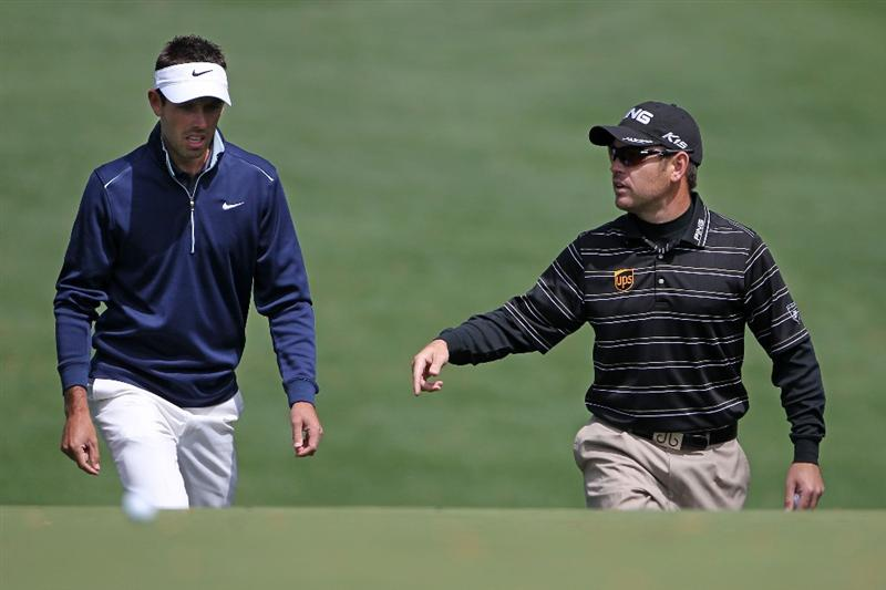 AUGUSTA, GA - APRIL 05:  Charl Schwartzel (L) and Louis Oosthuizen of South Africa walk to a green during a practice round prior to the 2011 Masters Tournament at Augusta National Golf Club on April 5, 2011 in Augusta, Georgia.  (Photo by Jamie Squire/Getty Images)