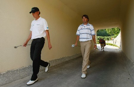 SHENZHEN, CHINA - NOVEMBER 24:  Maarten Lafeber and Robert - Jan Derksen of The Netherlands walk through a tunnel during the third round of the Omega Mission Hills World Cup at the Mission Hills Golf Resort on November 24, 2007 in Shenzhen, China.  (Photo by Stuart Franklin/Getty Images)