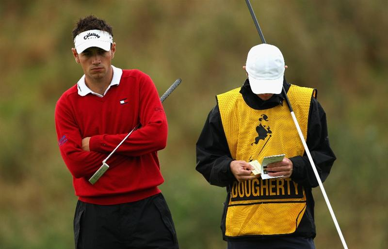PERTH, UNITED KINGDOM - AUGUST 28:  Nick Dougherty of England and his caddie look dejected on the 12th hole during the first round of The Johnnie Walker Championship at Gleneagles on August 28, 2008 at the Gleneagles Hotel and Resort in Perthshire, Scotland.  (Photo by Andrew Redington/Getty Images)