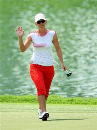 SINGAPORE - MARCH 06:  Louise Friberg of Sweden waves to the crowd during the second round of the HSBC Women's Champions at Tanah Merah Country Club on March 6, 2009 in Singapore.  (Photo by Andrew Redington/Getty Images)
