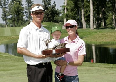 John Senden holds the trophy with his wife Jackie and their son Jacob after winning the John Deere Classic at TPC Deere Run in Silvis, Illinois on July 16, 2006.Photo by Michael Cohen/WireImage.com
