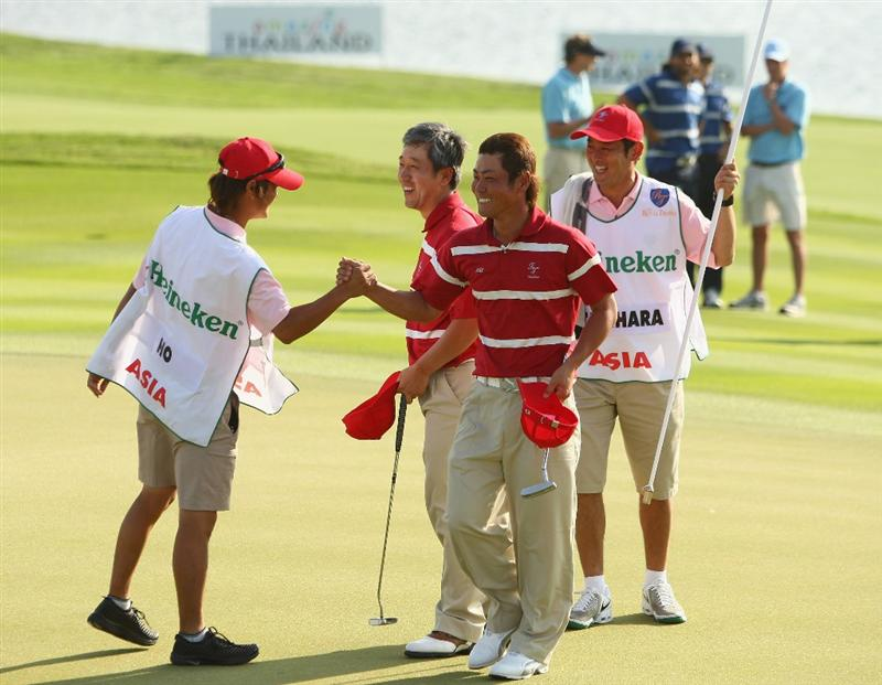 BANGKOK, THAILAND - JANUARY 09:  Hideto Tanihara and S.K. Ho celebrate after winning there match during the foursomes on Day one of The Royal Trophy at the Amata Spring Country Club on January 9, 2009 in Bangkok, Thailand.  (Photo by Ian Walton/Getty Images)