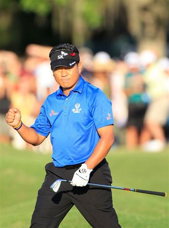 PONTE VEDRA BEACH, FL - MAY 15:  K.J. Choi of South Korea reacts to his chip shot on the 18th hole during the final round of THE PLAYERS Championship held at THE PLAYERS Stadium course at TPC Sawgrass on May 15, 2011 in Ponte Vedra Beach, Florida.  (Photo by Sam Greenwood/Getty Images)