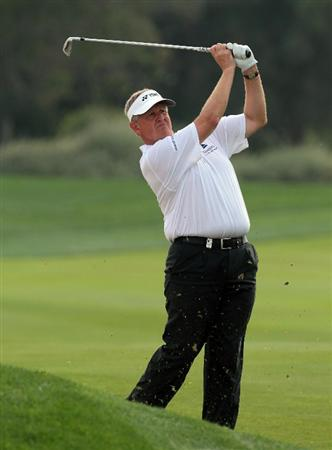 ABU DHABI, UNITED ARAB EMIRATES - JANUARY 22:  Colin Montgomerie of Scotland playing his second shot at the 13th hole during the third round of the 2011 Abu Dhabi HSBC Golf Championship held at the Abu Dhabi Golf Club on January 22, 2011 in Abu Dhabi, United Arab Emirates.  (Photo by David Cannon/Getty Images)