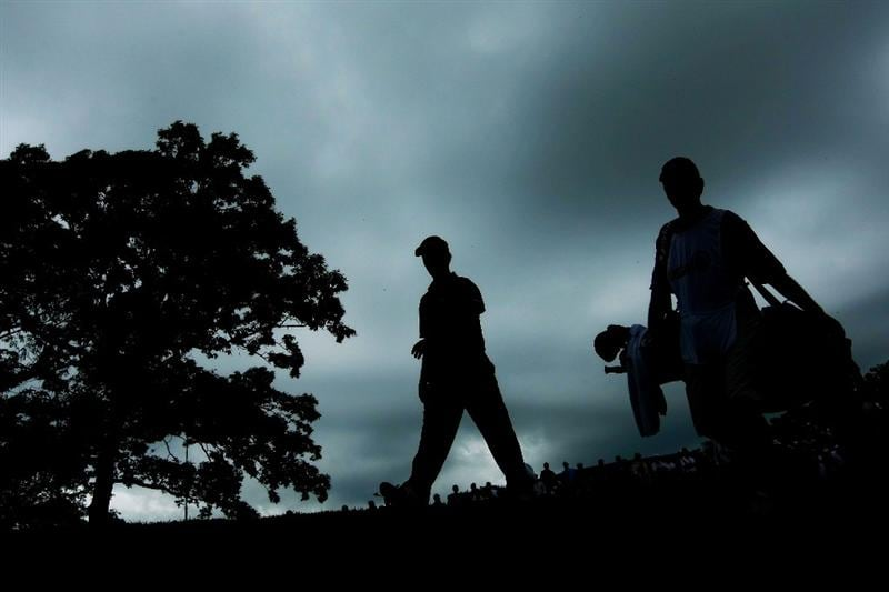 FARMINGDALE, NY - JUNE 21:  Mike Weir of Canada walks to the 18th green with his caddie Brennan Little  during the continuation of the third round of the 109th U.S. Open on the Black Course at Bethpage State Park on June 21, 2009 in Farmingdale, New York.  (Photo by Chris McGrath/Getty Images)