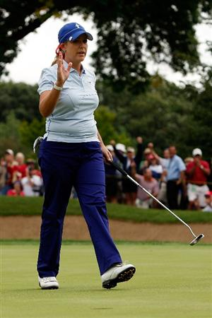 SUGAR GROVE, IL - AUGUST 21:  Cristie Kerr of the U.S. Team reacts after making a putt on the 14th hole during the Friday morning Fourball matches at the 2009 Solheim Cup at Rich Harvest Farms on August 21, 2009 in Sugar Grove, Illinois.  Kerr and Paula Creamer defeated Suzann Pettersen and Sophie Gustafson of the European Team .  (Photo by Chris Graythen/Getty Images)