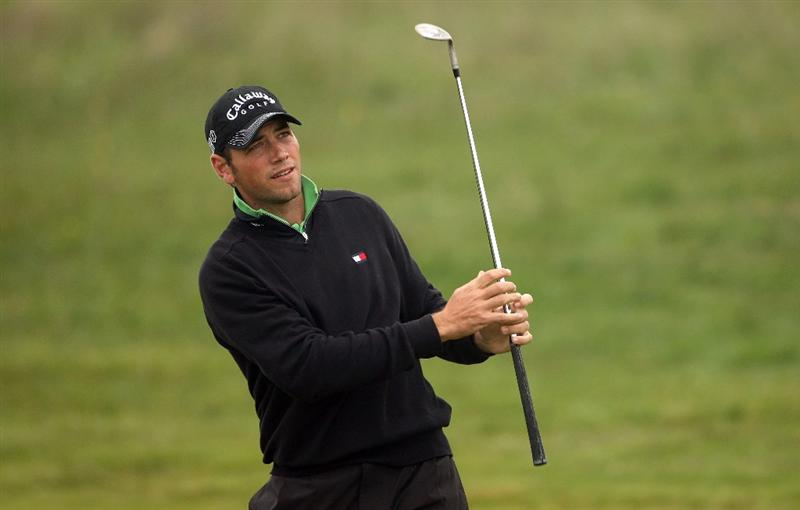 BALTRAY, IRELAND - MAY 14:  Nick Dougherty of England plays his approach shot on the ninth hole during the first round of The 3 Irish Open at County Louth Golf Club on May 14, 2009 in Baltray, Ireland.  (Photo by Andrew Redington/Getty Images)