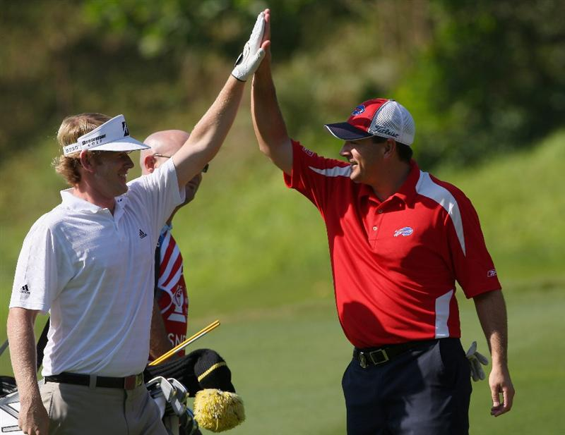 SHENZHEN, CHINA - NOVEMBER 27: Brandt Snedeker of USA celebrates holing his approach shot on the fourth hole with playing partner Ben Curtis of USA during the first round of the Omega Mission Hills World Cup at the Mission Hills Resort on November 27, 2008 in Shenzhen, China.  (Photo by Stuart Franklin/Getty Images)