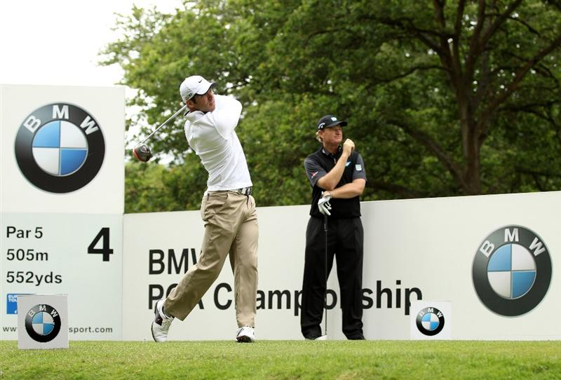 VIRGINIA WATER, ENGLAND - MAY 28:  Paul Casey of England tees off on the 4th hole as Ernie Els of South Africa looks on during the third round of the BMW PGA Championship at the Wentworth Club on May 28, 2011 in Virginia Water, England.  (Photo by Ross Kinnaird/Getty Images)