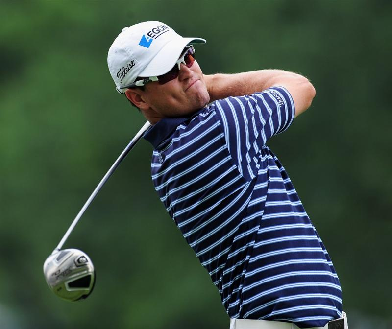 AKRON, OH - AUGUST 04:  Zach Johnson of the U.S. plays his tee shot during a practice round of the World Golf Championship Bridgestone Invitational on August 4, 2009 at Firestone Country Club in Akron, Ohio.  (Photo by Stuart Franklin/Getty Images)