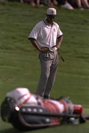 28 Sep 1997:  Tiger Woods of the USA contemplates his putt during the final day singles of the Johnnie Walker Ryder Cup at the Valderrama Golf Club in Sotogrande in Spain. Woods lost 4&2 to Costantino Rocca of Europe.  \ Mandatory Credit: Jamie Squire /Allsport