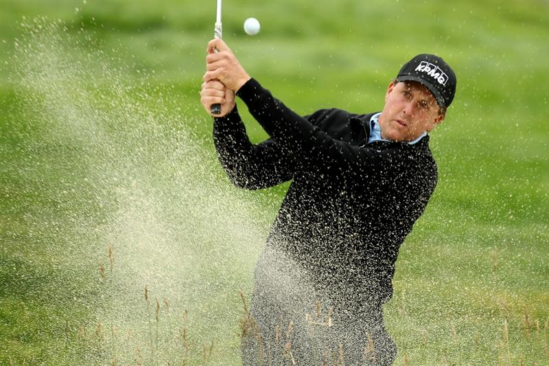 PEBBLE BEACH, CA - JUNE 15:  Phil Mickelson plays from a bunker during a practice round prior to the start of the 110th U.S. Open at Pebble Beach Golf Links on June 15, 2010 in Pebble Beach, California.  (Photo by Ross Kinnaird/Getty Images)