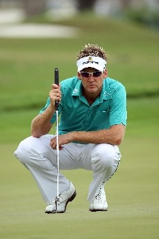 MIAMI - MARCH 20:  Ian Poulter of England lines up a birdie putt at the 10th hole during the first round of the 2008 World Golf Championships CA Championship at the Doral Golf Resort & Spa, on March 20, 2008 in Miami, Florida.  (Photo by David Cannon/Getty Images)